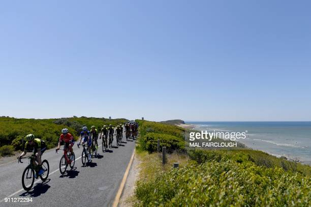 The peloton passes 13th beach during the Cadel Evans Great Ocean Road cycling race near Geelong on January 28 2018 / AFP PHOTO / Mal Fairclough /...