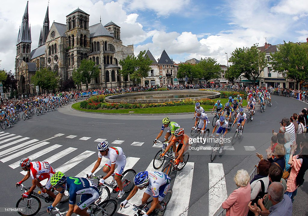The peloton passes a cathedral during stage six of the 2012 Tour de France from Epernay to Metz on July 6, 2012 in Chalons, France.