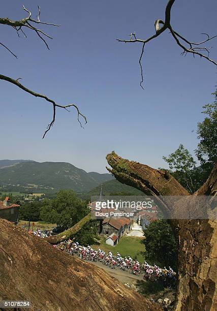 The peloton passes Antichan de Frontignes as they climb the Col des Ares during stage 13 of the Tour de France on July 17 2004 from Lannemezan to...