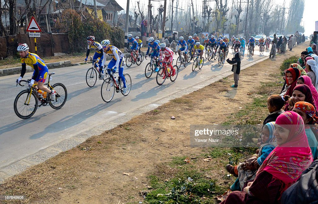 The peloton passes by the Tour De India International Cycling Race on the banks of Dal Lake on December 04, 2012 in Srinagar, Indian Administered Kashmir, India. Cashing on the high tourist influx in the region, Tour De India International Cycling Race on the banks of Dal Lake in Srinagar the capital of Indian Adminsitered Kashmir on Tuesday. The race was flagged off by Chief Minister, Omar Abdullah with 120 cyclists belonging to 13 countries taking part in the international cycling event that is being held for the first time conflict torn region. Reputed cyclists from India, Thailand, UAE, Uzbekistan, Kazakhstan, Ireland and other countries participated in the event, the first leg of which was held in Mumbai some days back. Several cyclists from Kashmir also participated in the event.