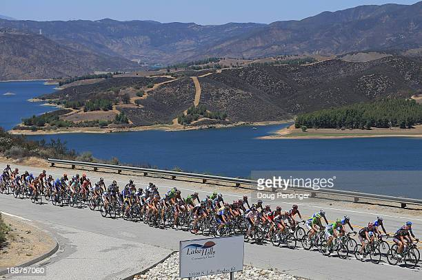 The peloton passes Castais Lake during Stage Three of the 2013 Amgen Tour of California from Palmdale to Santa Clarita on May 14 2013 in Castaic...