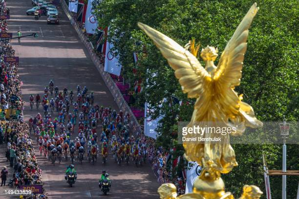The peloton passes down The Mall at the start of the the Men's Road Race Road Cycling on day 1 of the London 2012 Olympic Games on July 28 2012 in...