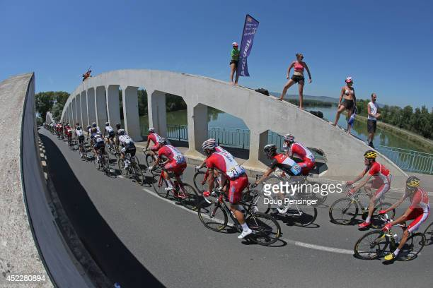 The peloton passes over La Saone River during the twelfth stage of the 2014 Tour de France, a 186km stage between Bourg-en-Bresse and Saint-Etienne,...
