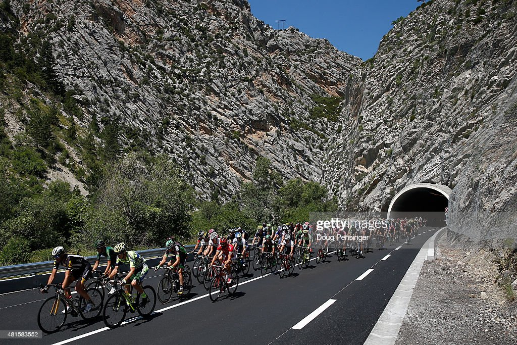 The peloton passes through a mountain tunnel as they begin to race during stage 17 of the 2015 Tour de France from Digne-Les-Bains to Pra Loup on July 22, 2015 in Digne-les-Bains, France.