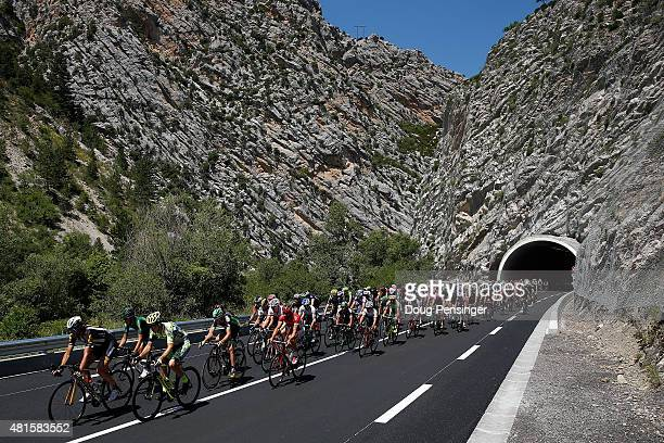 The peloton passes through a mountain tunnel as they begin to race during stage 17 of the 2015 Tour de France from DigneLesBains to Pra Loup on July...