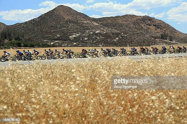 The peloton passes through a wheat field during Stage Two of the 2013 Amgen Tour of California from Murrieta to Palm Springs on May 13, 2013 in...