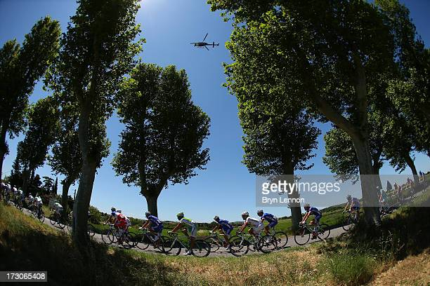 The peloton passes through countryside during stage eight of the 2013 Tour de France a 195KM road stage from Castres to Ax 3 Domaines on July 6 2013...