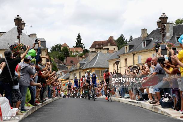 The peloton passes through during stage 10 of the 2017 Le Tour de France, a 178km stage from Perigueux to Bergerac on July 11, 2017 in Perigueux,...
