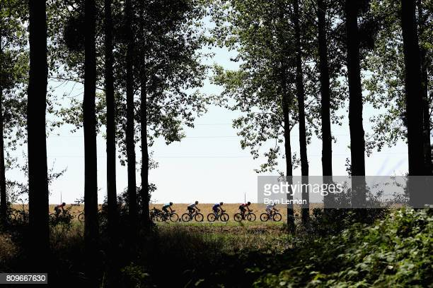 The peloton passes through during stage six of the 2017 Le Tour de France, a 216km road stage from Troyes to to Vesoul on July 6, 2017 in Troyes,...