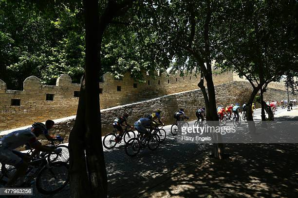 The peloton passes through the Old Town during the Men's Cycling Road Race on day nine of the Baku 2015 European Games at Freedom Square on June 21...