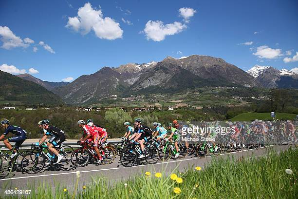 The peloton passes through the village of Dasindo during stage three of the Giro del Trentino from Mori to Roncone on April 24 2014 in Trento Italy