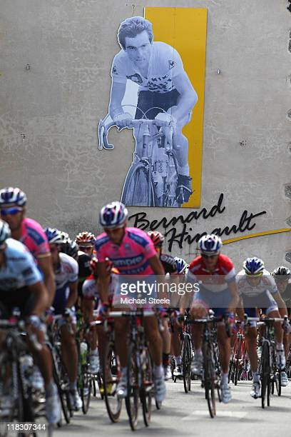 The peloton passes through Yffiniac the home town of racing legend Bernard Hinault during Stage 5 of the 2011 Tour de France from Carhaix to Cap...