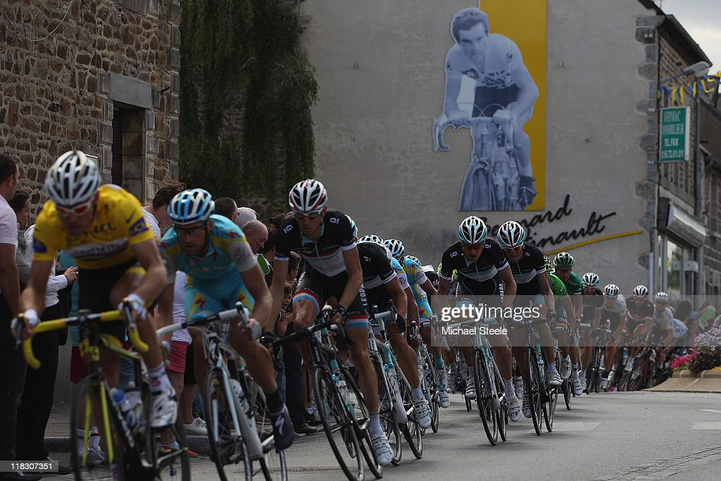 The peloton passes through Yffiniac the home town of racing legend Bernard Hinault during Stage 5 of the 2011 Tour de France from Carhaix to Cap Frehel on July 6, 2011 in Cap Frehel, France.