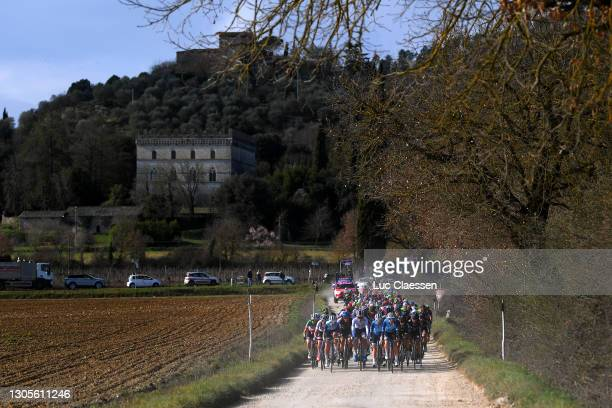 The Peloton passing through a gravel strokes sector during the Eroica - 7th Strade Bianche 2021, Women's Elite a 136km race from Siena to Siena -...