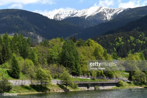 The peloton passing through Baselga di Pine mountain landscape during the 104th Giro d'Italia 2021, Stage 17 a 193km stage from Canazei to Sega di...
