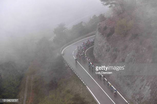 The Peloton passing through foggy landscape at climb of Suen during the 74th Tour De Romandie 2021, Stage 4 a 161,3km stage from Sion to Thyon 2000 -...