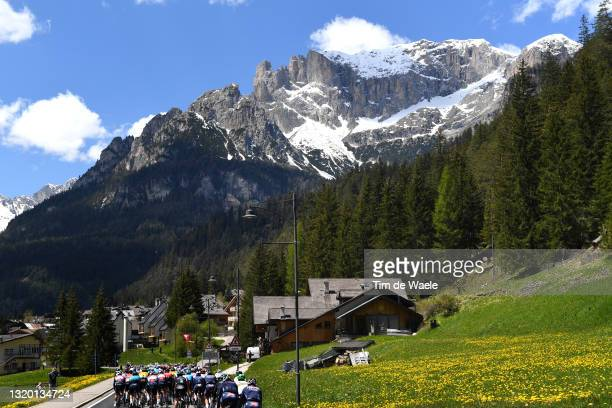 The peloton passing through mountain landscape during the 104th Giro d'Italia 2021, Stage 17 a 193km stage from Canazei to Sega di Ala 1246m / The...