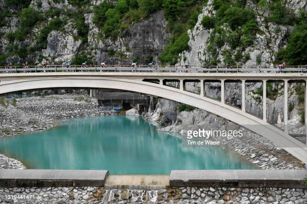 The Peloton passing through Ravedis Bridge in Maniago Village during the 104th Giro d'Italia 2021, Stage 14 a 205km stage from Cittadella to Monte...