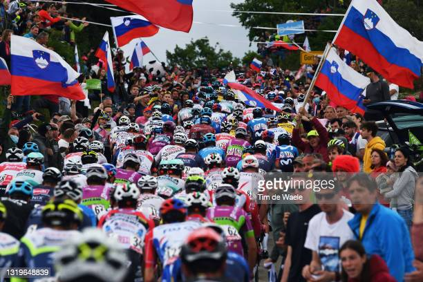 The Peloton passing through Slovenia - Gornje Cerovo during the 104th Giro d'Italia 2021, Stage 15 a 147km stage from Grado to Gorizia / Fans /...