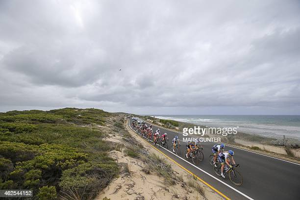 The peloton races along side the Great Ocean Road near Barwon Heads during the 2015 Cadel Evans Great Ocean Road Race Women's Elite Race in Geelong...