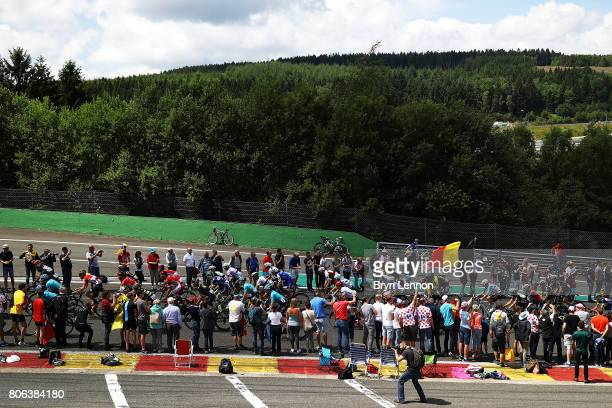The peloton Raidillon on the SpaFrancorchamps racing circuit on stage three of the 2017 Tour de France on July 3 2017 in Spa France