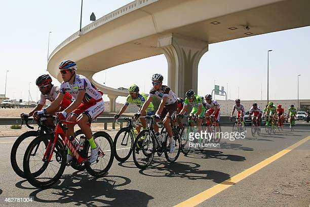 The peloton ride along a highway on stage two of the Dubai Tour from the Dubai International Marine Club to Palm Jumeirah on February 5 2015 in Dubai...