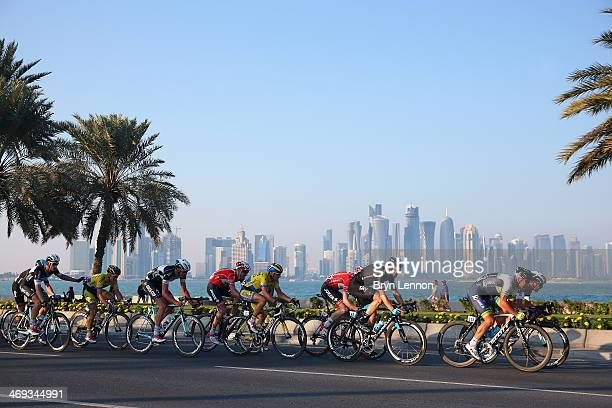 The peloton ride along the Doha Corniche during stage six of the Tour of Qatar from Sealine Beach Resort to Doha Corniche on February 14, 2014 in...