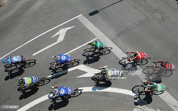 The peloton ride on stage ten of the 2013 Tour de France a 197KM road stage from StGildasdesBois to Saint Malo on July 9 2013 in St Malo France