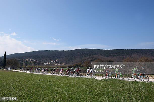 The peloton ride over the unmade roads of Tuscany during the 2014 Strade Bianchi from to San Gimignano to Siena ll Campo on March 8 2014 in Siena...