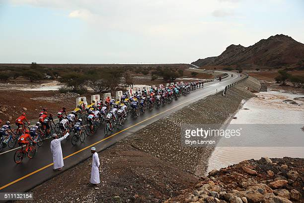 The peloton ride pass a flash flood after bad weather on stage three of the 2016 Tour of Oman a 1765km road stage from Al Sawadi Beach to Naseem...