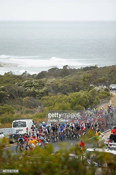 The peloton ride past Bells Beach during the Cadel Evans Ocean Road Race on February 1 2015 in Melbourne Australia