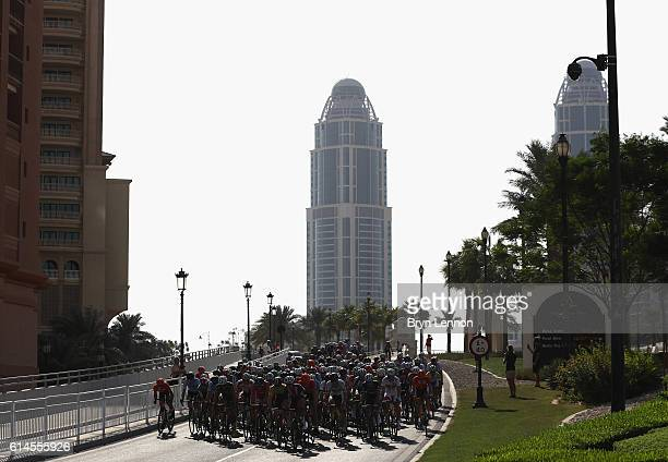 The peloton ride past during the Men Juniors Road Race on Day Six of the UCI Road World Championships at The Pearl on October 14 2016 in Doha Qatar