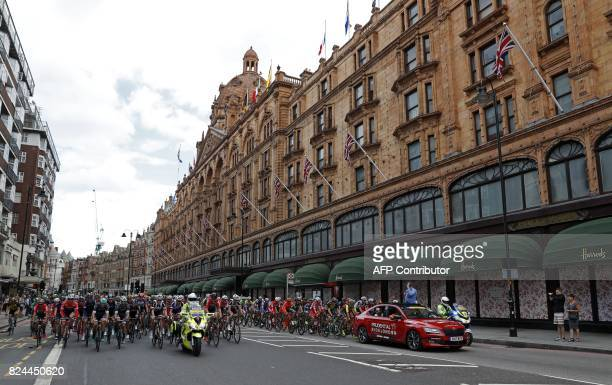 TOPSHOT The peloton ride past Harrods department store on Brompton Road in west london at the start of the Prudential RideLondonSurrey Classic 2017...