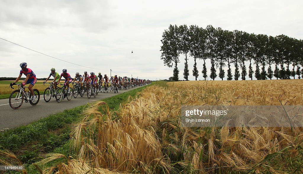 The peloton ride through the French countryside during stage five of the 2012 Tour de France from Rouen to Saint-Quentin on July 5, 2012 in Saint-Quentin, France.