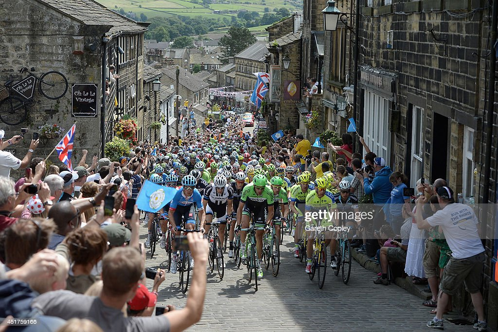 The Peloton ride up Haworth High Street during Stage Two of Le Tour de France on July 6, 2014 in Haworth, England.
