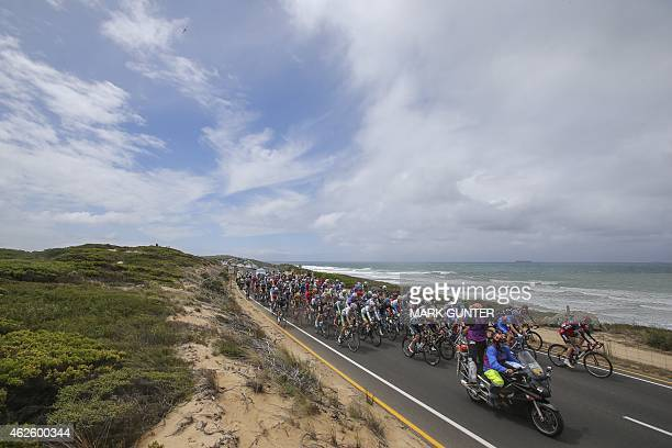 The peloton rides along the Great Ocean Road during the 2015 Cadel Evans Great Ocean Road Race Men's Elite Race in Geelong on February 1 2015 AFP...