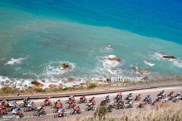TOPSHOT The peloton rides along the sea during the 4th stage of the 100th Giro d'Italia Tour of Italy cycling race from Cefalu to Etna volcano on May...