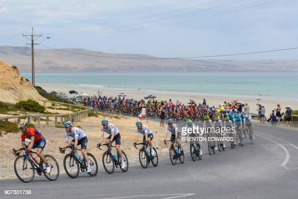The peloton rides along the South Australian coastline on the fifth day of the Tour Down Under cycling race in Adelaide on January 20 2018 / AFP...