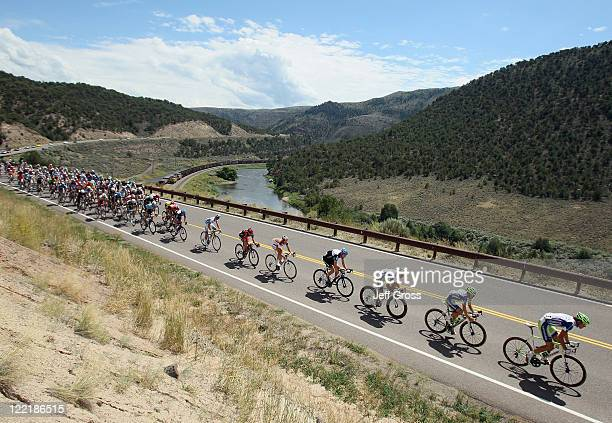 The peloton rides alongside a river during stage four of the 2011 USA Pro Cycling Challenge from Avon to Steamboat Springs on August 26 2011 in Bond...
