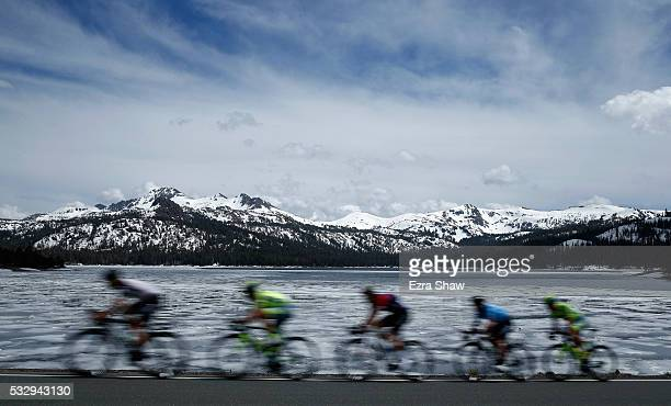 The peloton rides by Caples Lake during Stage 5 of the Tour of California from Lodi to South Lake Tahoe on May 19 2016 in Kirkwood California