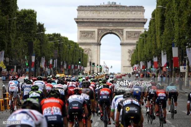 The peloton rides down the ChampsElysees towards the Arc de Triomphe during stage 21 of the 2017 Le Tour de France a 103km stage from Montgreon to...