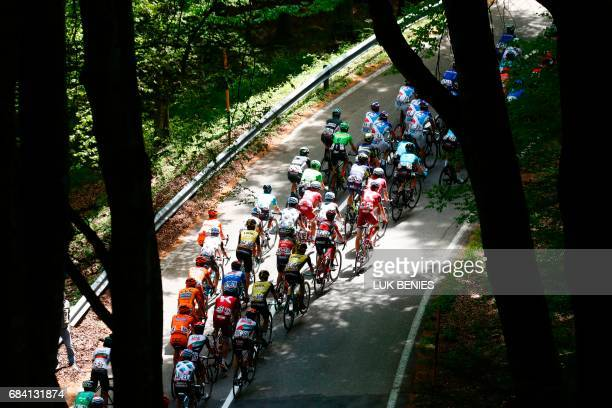 The peloton rides during the 11th stage of the 100th Giro d'Italia Tour of Italy cycling race from Florence to Bagno di Romagna on May 17 2017 / AFP...