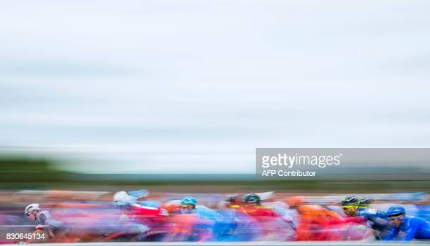 TOPSHOT The peloton rides during the 1845 km second stage of the Arctic Race of Norway between Sjoevegan and Bardufoss Airport in Norway on August 11...