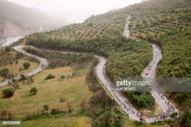 The peloton rides during the 7th stage of the 100th Giro d'Italia Tour of Italy cycling race from Castrovillari to Alberobello on May 12 2017 / AFP...