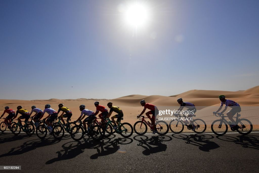 TOPSHOT - The peloton rides during the first stage of the 2018 Abu Dhabi Tour in the Emirati capital on February 21, 2018. /