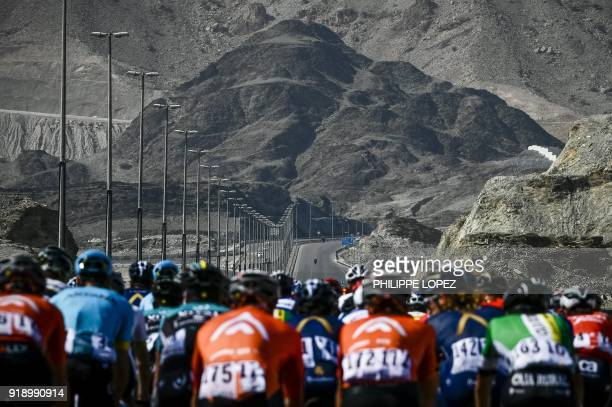 TOPSHOT The peloton rides during the fourth stage of the cycling Tour of Oman between Yiti and Ministry of Tourism near Al Amerat on February 16 2018...