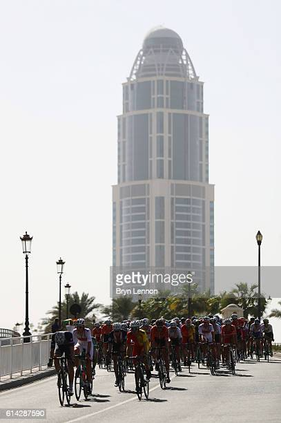 The peloton rides during the Men's Under 23 Road Race on Day Five of the UCI Road World Championships at The Pearl on October 13 2016 in Doha Qatar