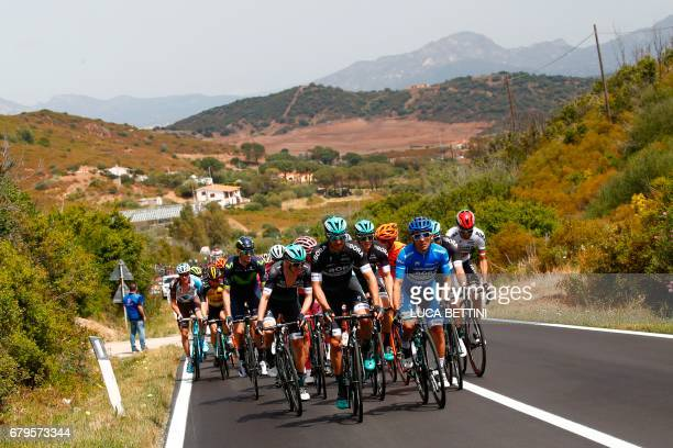 The peloton rides during the second stage of the 100th Giro d'Italia Tour of Italy from Olbia to Tortoli on May 6 2017 in Sardinia / AFP PHOTO / Luk...