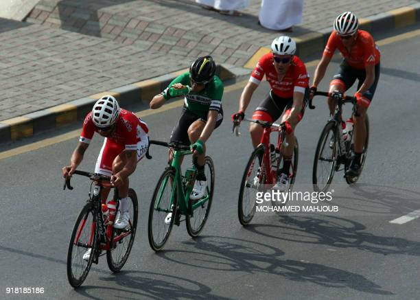 The peloton rides during the second stage of the 2018 cycling Tour of Oman from Sultan Qaboos University to AlBustan west of the capital Muscat on...