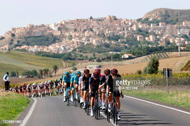 The peloton rides during the second stage of the 2020 Giro d'Italia, a 149 km route between Alcamo and Agrigento, in Agrigento on October 4, 2020.